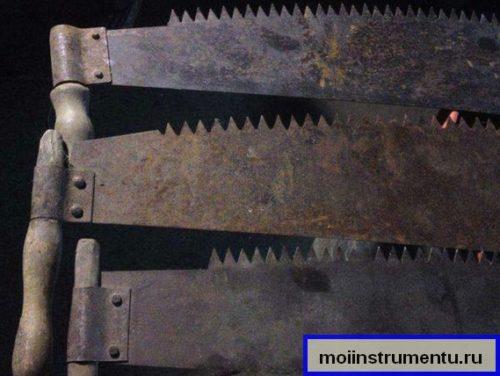 Зубья на двуручной ножовке
